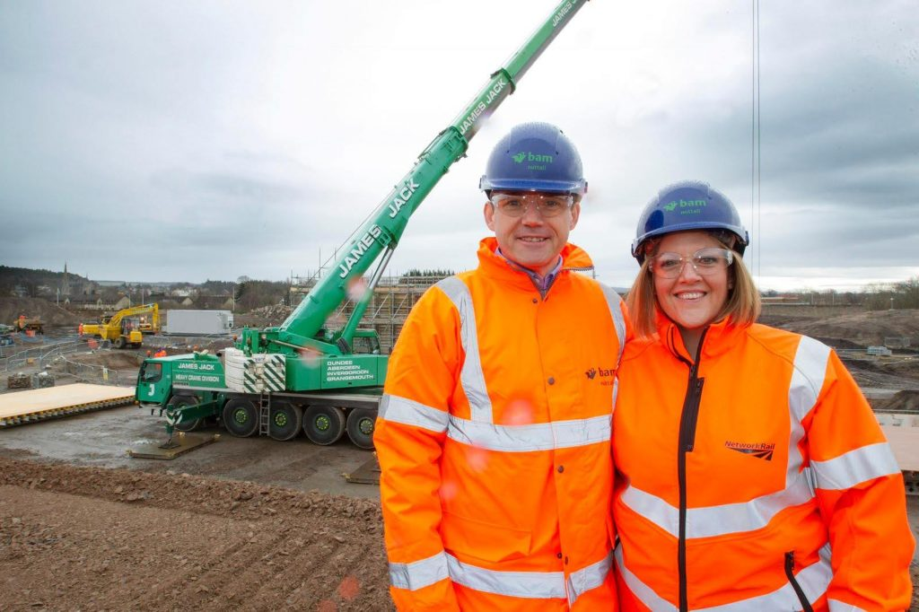 Why stories sell: A photograph of Stacey with a work colleague, both wearing bright orange reflective coats